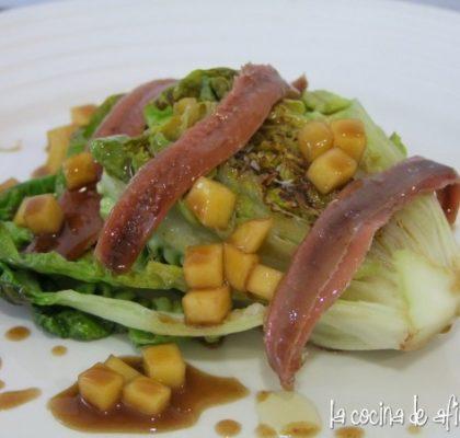Cogollos a la plancha con anchoas del Cantábrico y vinagreta de mango